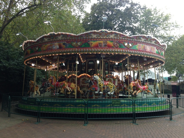 A beautiful animal themed Merry-Go-Round at the zoo.